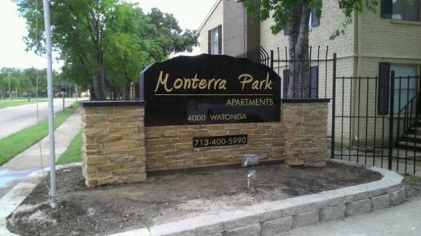 Apartment Complex in the Houston area stone and granite exterior sigange